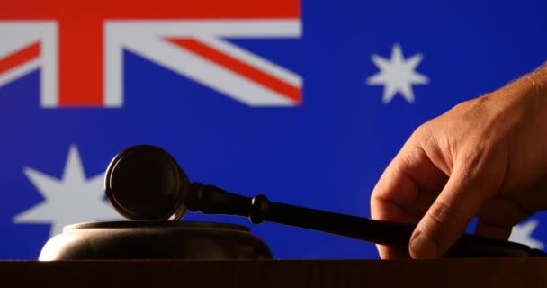 Judge calling order with hammer gavel in australain court with flag background