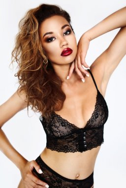 Seductive beautiful young African woman in underwear