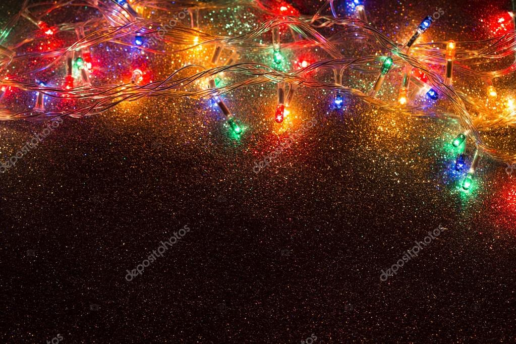 Christmas lights garland on a old antique wooden parquet floor