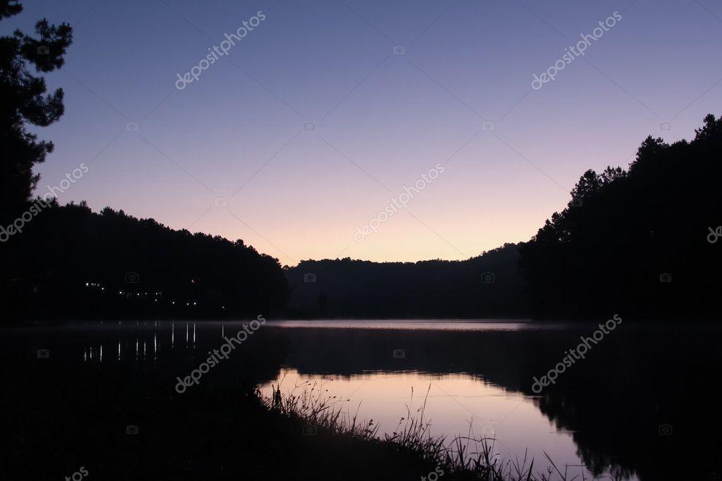 Lake with beautiful twilight sky in purple.