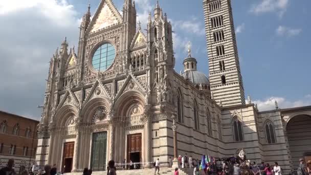 SIENA, ITALY - The famous cathedral in Siena, dedicated to Santa Maria Assunta, designed and completed between 1215 and 1263 in the city of Siena in Italy, ULTRA HD 4k, real time