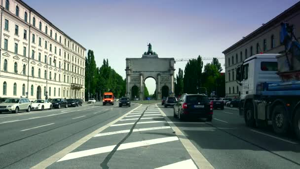 MUNICH: Morning traffic on Ludwigstrasse boulevard  in Munich, Germany. This broad avenue and the Siegestor gate in the background are landmarks of the city.real time,4k,ultra hd 4k