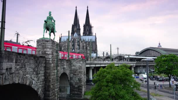 COLOGNE, GERMANY:Exterior of Cologne train station with trains moving in and out and Cathedral in the background. ULTRA HD 4K, real time, zooming