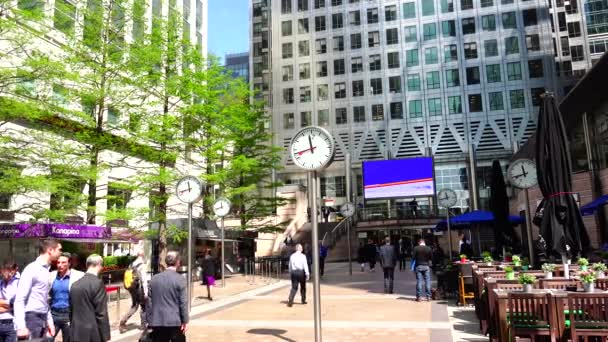LONDON : Businessmen going to work in Canary Wharf in London. Canary Wharf is a major business district with around 14,000,000 square feet of office and retail space.4k,ultra hd 4k, real time