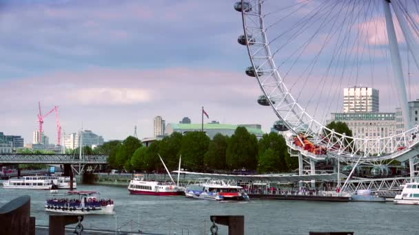 LONDON : London skyline with London Eye on Thames river in a cloudy day in London, UK. London Eye is the tallest Ferris wheel in Europe at 135 meters. ULTRA HD 4K, REAL TIME