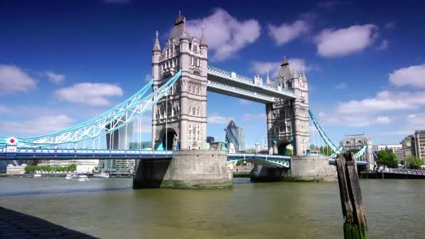 LONDON : Traffic crosses Tower Bridge  in London. Tower Bridge is an iconic symbol of London; ULTRA HD 4k,real time, zoom