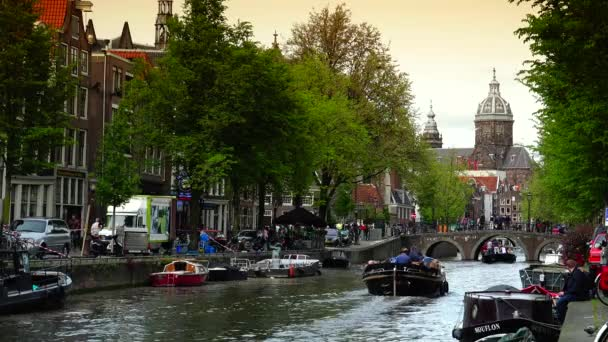 AMSTERDAM, NETHERLANDS : Canal and St. Nicolas Church in Amsterdam. Amsterdam is the capital and most populous city of the Netherlands ; ULTRA HD 4K, real time