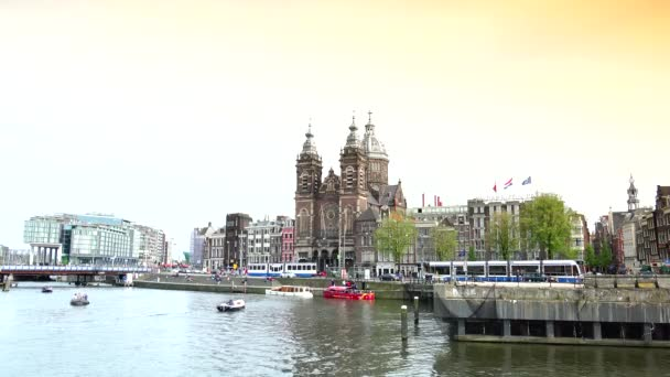 AMSTERDAM: Amsterdam cityscape with Saint Nicholas Basilica . St Nicholas, located in the Old Centre area, is the citys major Catholic Church.ULTRA HD 4k,real time