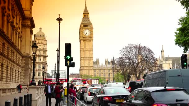 LONDON: Traffic near Houses of Parliament and Big Ben in London  The Palace  of Westminster is a UNESCO site  Ultra hd 4k, real time,zooming