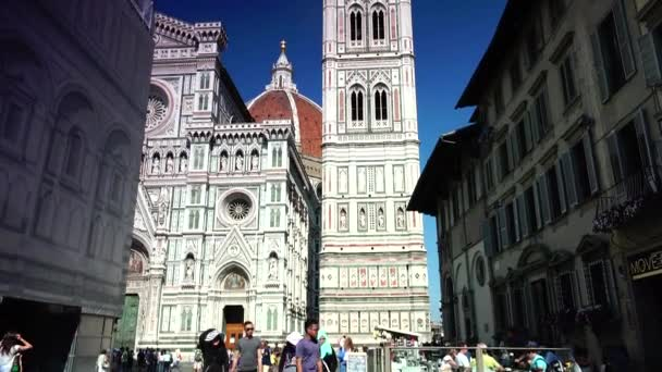 FLORENCE, ITALY: Italian and world travelers enjoy walk in the Piazza del Duomo, then take a tour in the cathedral church (Duomo) of Florence,ULTRA HD 4K, real time, zooming