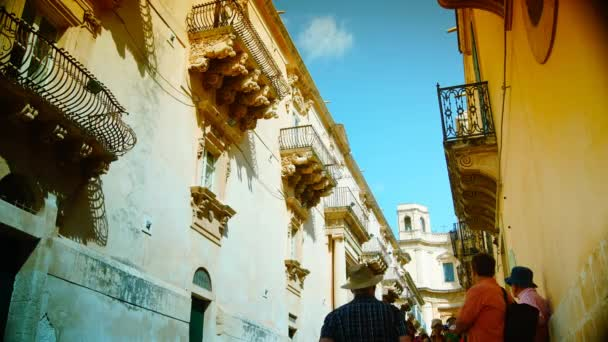 Italy, Sicily, Noto (Siracusa Province): Villadorata Nicolaci Palace (Unesco monument), baroque ornamental statues under the balconies, time lapse