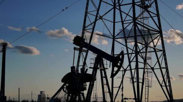 Oil Derrick mechanism in the sunset,hd