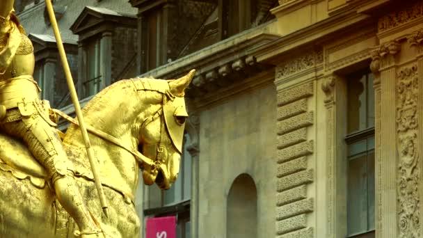 Paris, France :Gilded bronze equestrian statue (Sculptor Emmanuel Fremiet, 1874) depicting Saint Jeanne d Arc (Joan of Arc). Place des Pyramides, Paris, France, ultra hd 4k, real