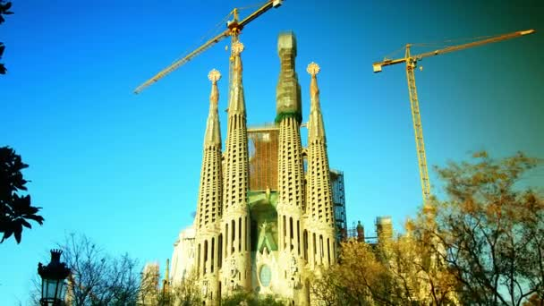 BARCELONA, SPAIN - MARCH 03, 2015: Cathedral Sagrada Familia famous church and landmark with tourists and locals traffic cars in BARCELONA, time lapse