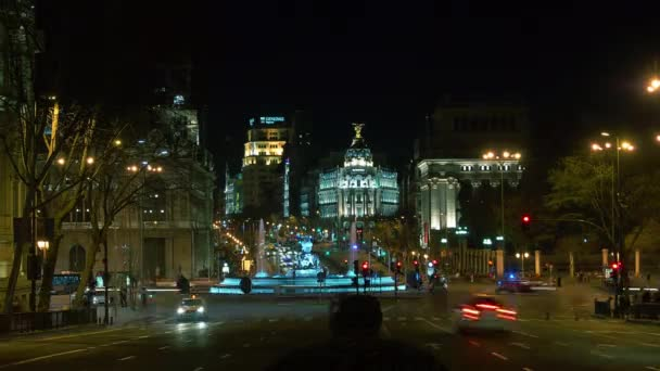 MADRID - MARCH 10: Traffic at Cibeles Square near old post office building on 10 March 2015 in Madrid, Spain. Post office building was home to Postal and Telegraphic Museum until 2007. time lapse