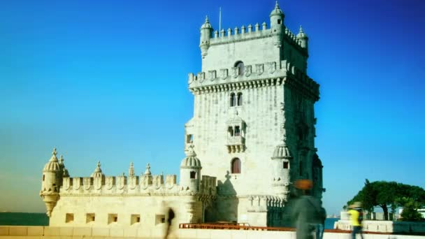 Lisbon, Portugal - 31 MAR: Tourists enter and exit the Torre de Belem in Lisbon, Portugal. The landmark medieval tower is located at the Tejo River in Belem, a famous district of Lisbon. time lapse