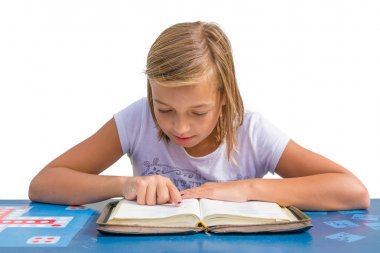 Child having devotional studying holy bible smiling