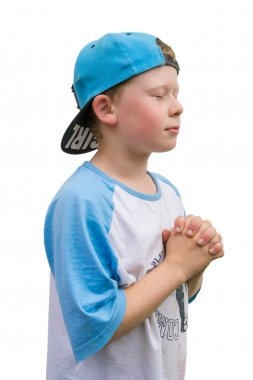 Faithful child praying to Jesus with folded hands and closed eye
