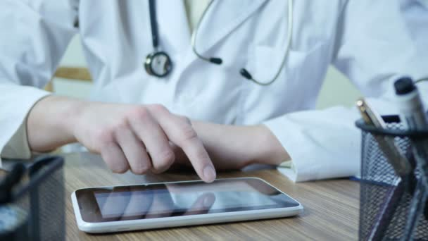 Doctor Using Tablet Pc In Office