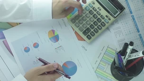 Business Calculations Man Using Calculator. Calculating Business Finance.