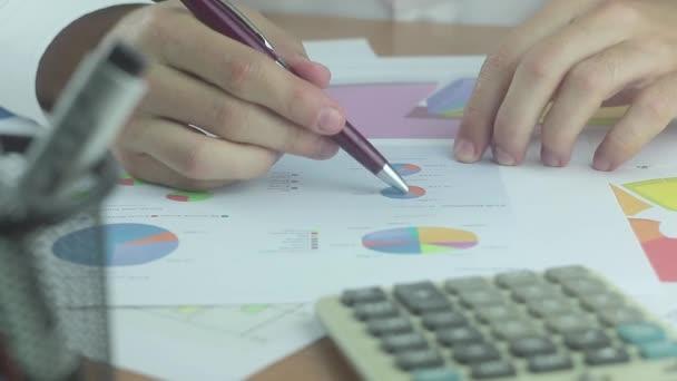 Analyzing Financial Report. Man Using Calculator.