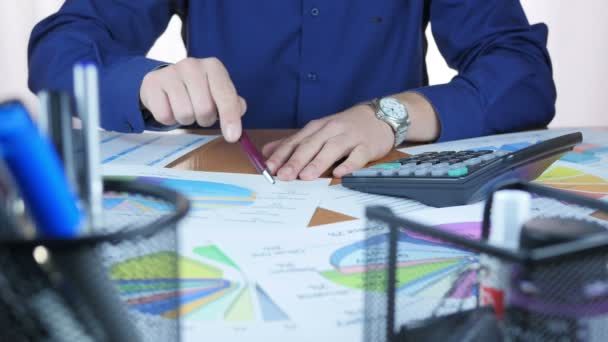 Businessman Examining Business Graph And Calculating Profit