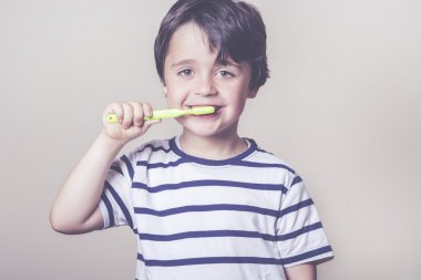 happy child brushes his teeth