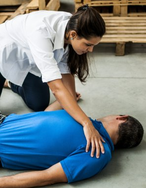 girl assisting an unconscious guy