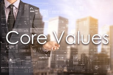 Businessman showing text by his hand: Core Values