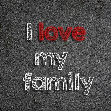 I love my family handwritten on black background