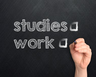 Studies or work decision handwritten on blackboard