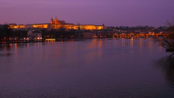Wide Static Shot of the Vltava River and Prague Castle at Dusk