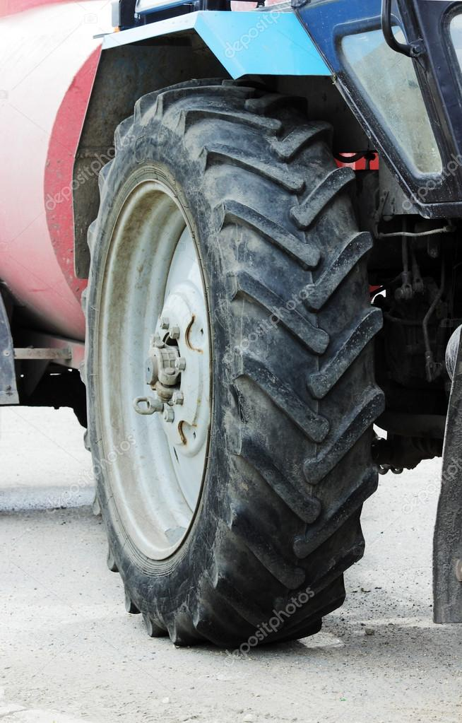 big wheel from the working farm tractor