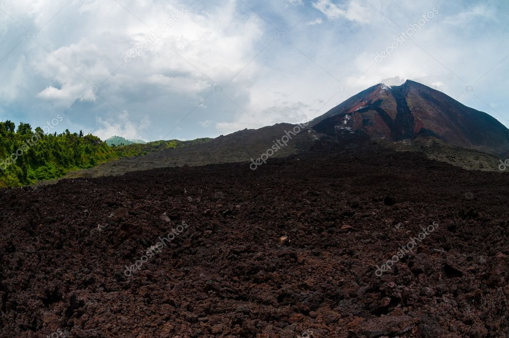 Cold lava residual in front of not active volcano near Antigua