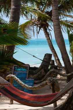Closeup of Hammock for relax chillout Tied to Coconut Trees at the beach on little Corn Island Bar