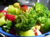 fresh vegetable salad with brocoli, pepper and olives