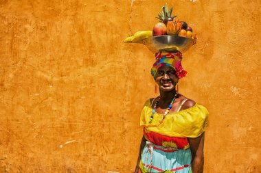 Colombian woman wearing traditional clothes in Cartegena de Indias, in Colombia.