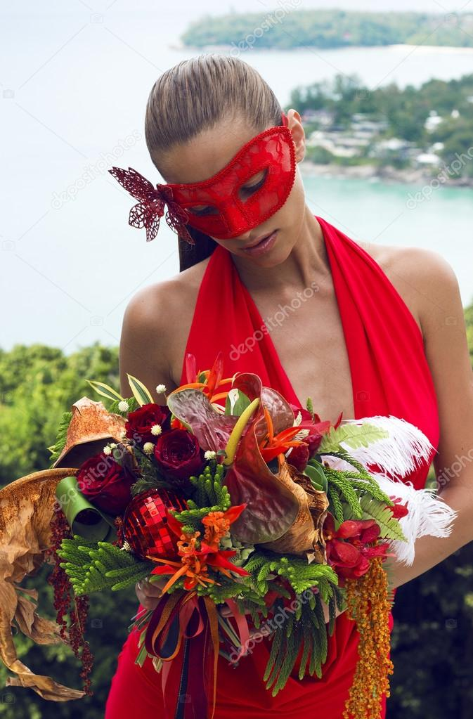 Beautiful Woman In Carnival Mask With Bouquet Flowers