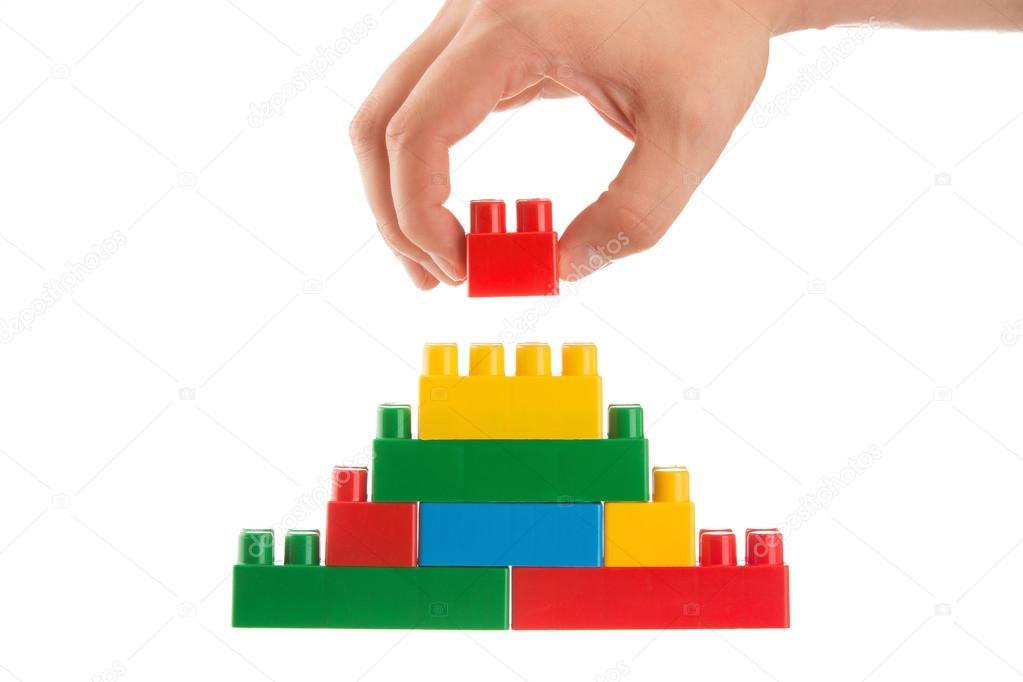 main de b tir un mur en empiler lego conception de l 39 entreprise photographie gerisima 88664094. Black Bedroom Furniture Sets. Home Design Ideas