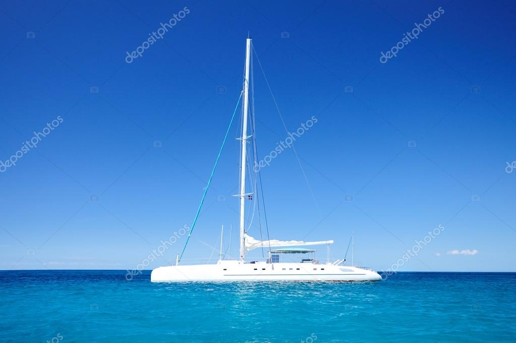 Sailing catamaran in the blue carribean sea