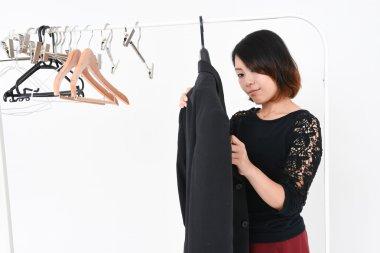 Woman hangs jacket on the hanger
