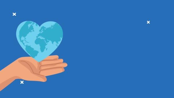 světový den srdce animace s ruční zvedání země s tvarem srdce
