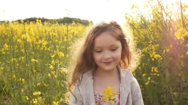 girl walking cross the field at sunset.Slow motion