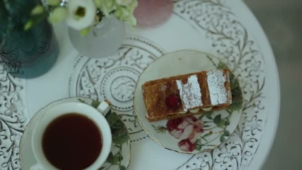 Tea and a piece of cake on vintage china sets