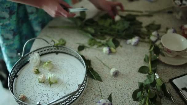 Florist prepares flowers for a floral composition