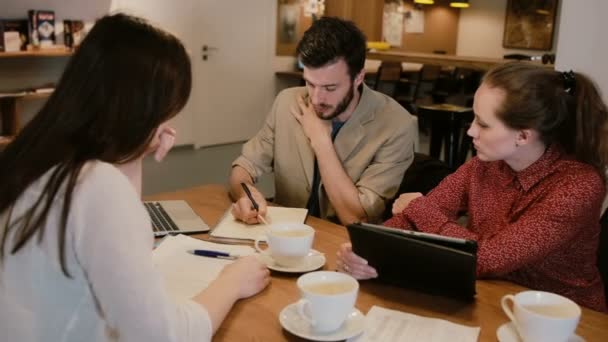 Small Business team meeting in cafe
