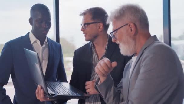 international business team in a modern office, female businessman, african man, elderly businessman
