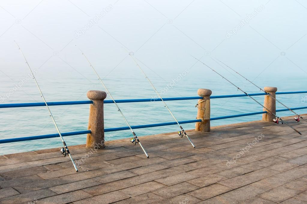 Fishing rods leaning on handrail