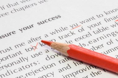 Red pencil proofreading concept