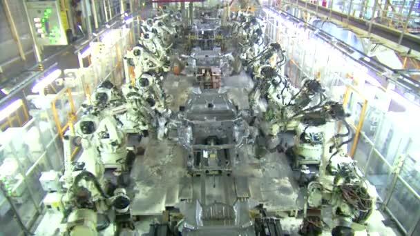 Roboti svařování auto